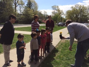 Mrs. Brennan's students enjoy a close up look at one of the flowers they will plant