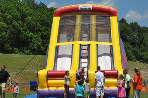 Kids slide down an inflatable slide.