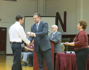 Nick Cowie receives his ring from Dr. Ken Greene
