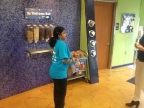 Dolly Ravishankar practicing helping a customer at Yo Addiction.