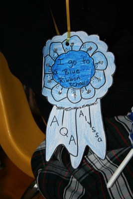 One of the Blue Ribbons Worn By All of the Students