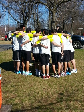 Livingston's Varsity Tennis Team Huddles