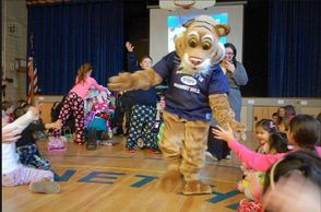 The School's Bobcat Mascot Leads the Students in Cheers