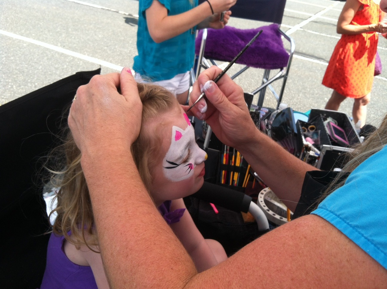 1604c263a757b7f88d3f_Evelyn_Lieberman_gets_face_painted.jpg