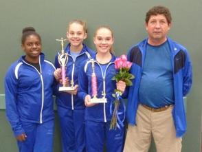 Taylor Milch, Grace Healey, Kellyn Shuster and Coach Ed Bell