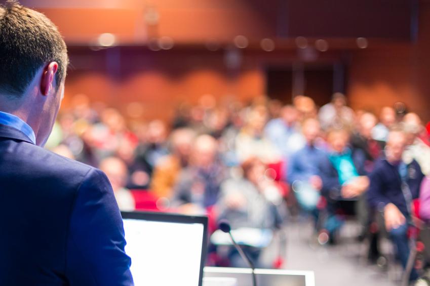 b12351d9c72c8e333c11_Speaker_at_conference.jpg