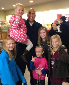 Sen Booker with Sparta Girls on the Run
