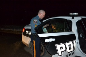 Cpl. Marc Rubino secures gang member Courry Rice in the rear of his patrol vehicle.  Rice's bail was set at $200,000.00 without a 10% option.