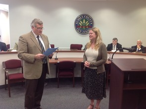 "George Graham presented the proclamation to Lorraine Hentz for ""Older Americans Month."""