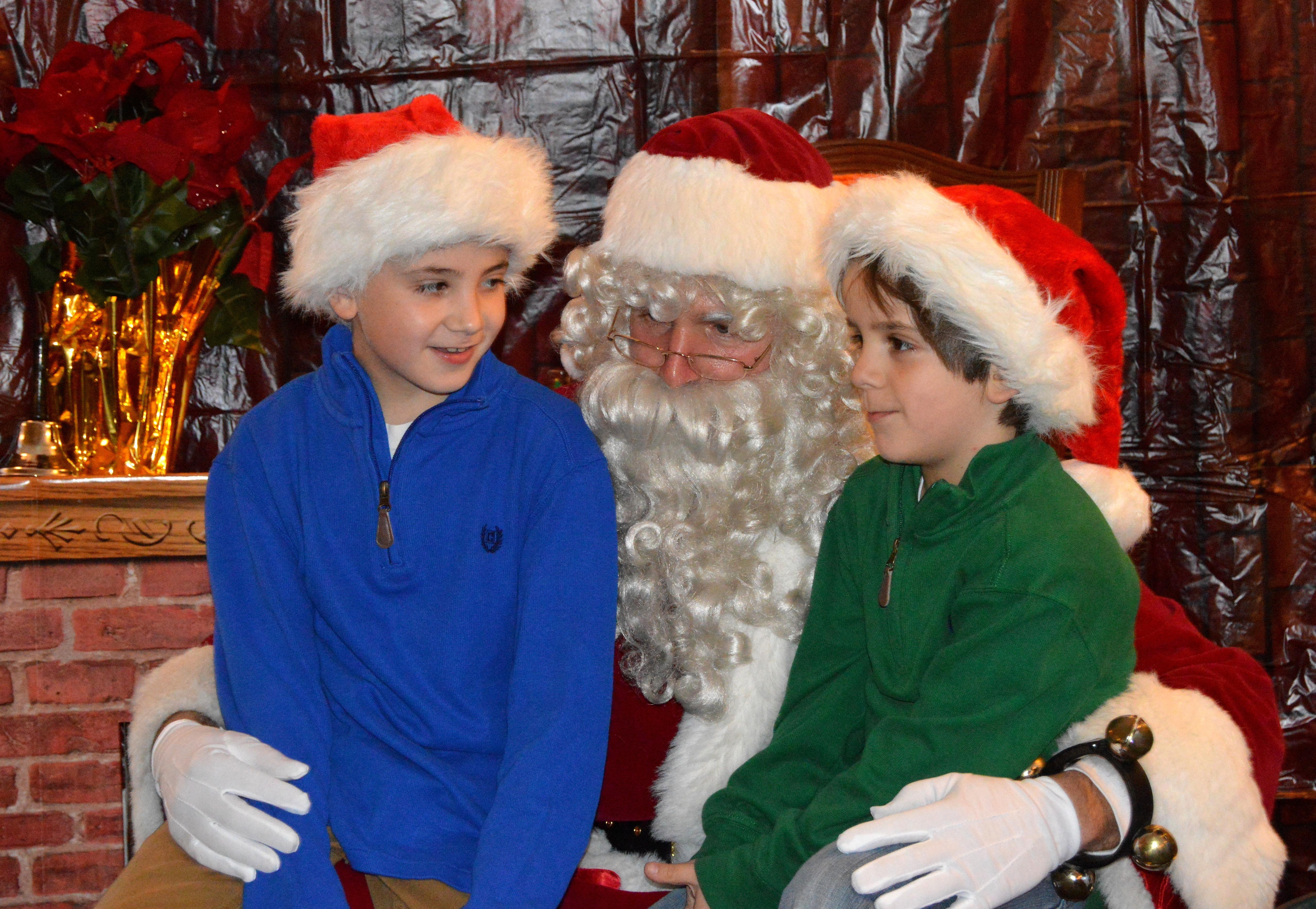 8b9e3b13ca4c45fe8025_Noah_and_Jonah_Tamayo_visit_Santa.JPG