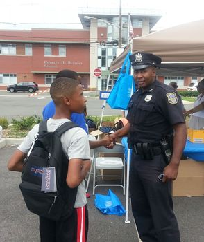 Officer Falaise and a student