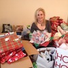 Small_thumb_5ad2436297be243fd5b2_hope_for_veterans_stacia_wrapping_gifts_2014