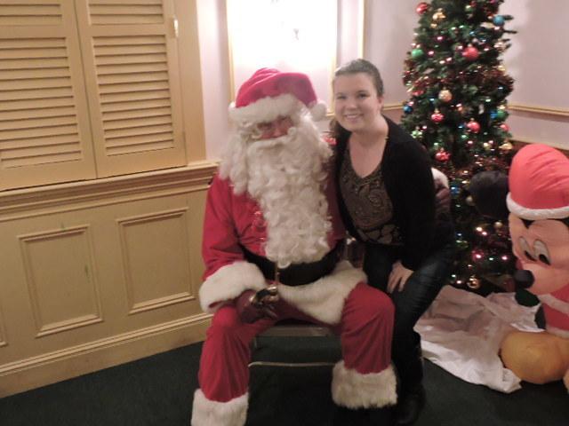 9d05ce358dbd3ceaaa90_Katie_with_Santa.jpg