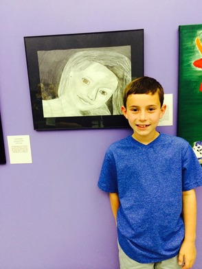Artist Ryan Stecklow with his artwork