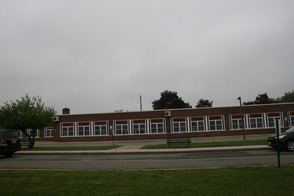 Lazar Middle School with looming PSE&G power lines behind