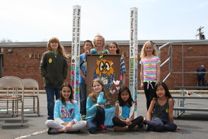 Woodruff School Celebrates Arbor Day/Earth Day with Peace Poles from the BHEF