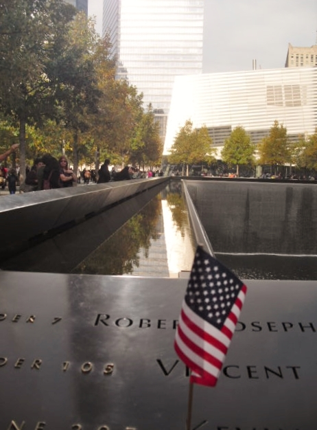 55542b6cbe0f628d3e97_Flag_at_World_Trade_Memorial.jpg