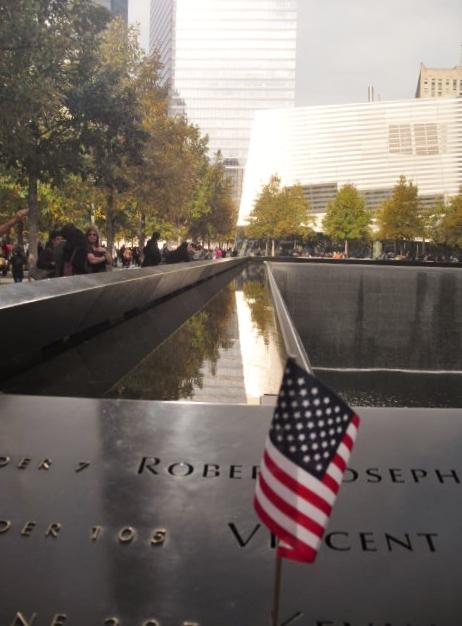 55542b6cbe0f628d3e97_Flag_at_World_Trade_Memorial.jpg
