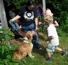 Melissa Neiss and former shelter dog Chase with farm camp kids