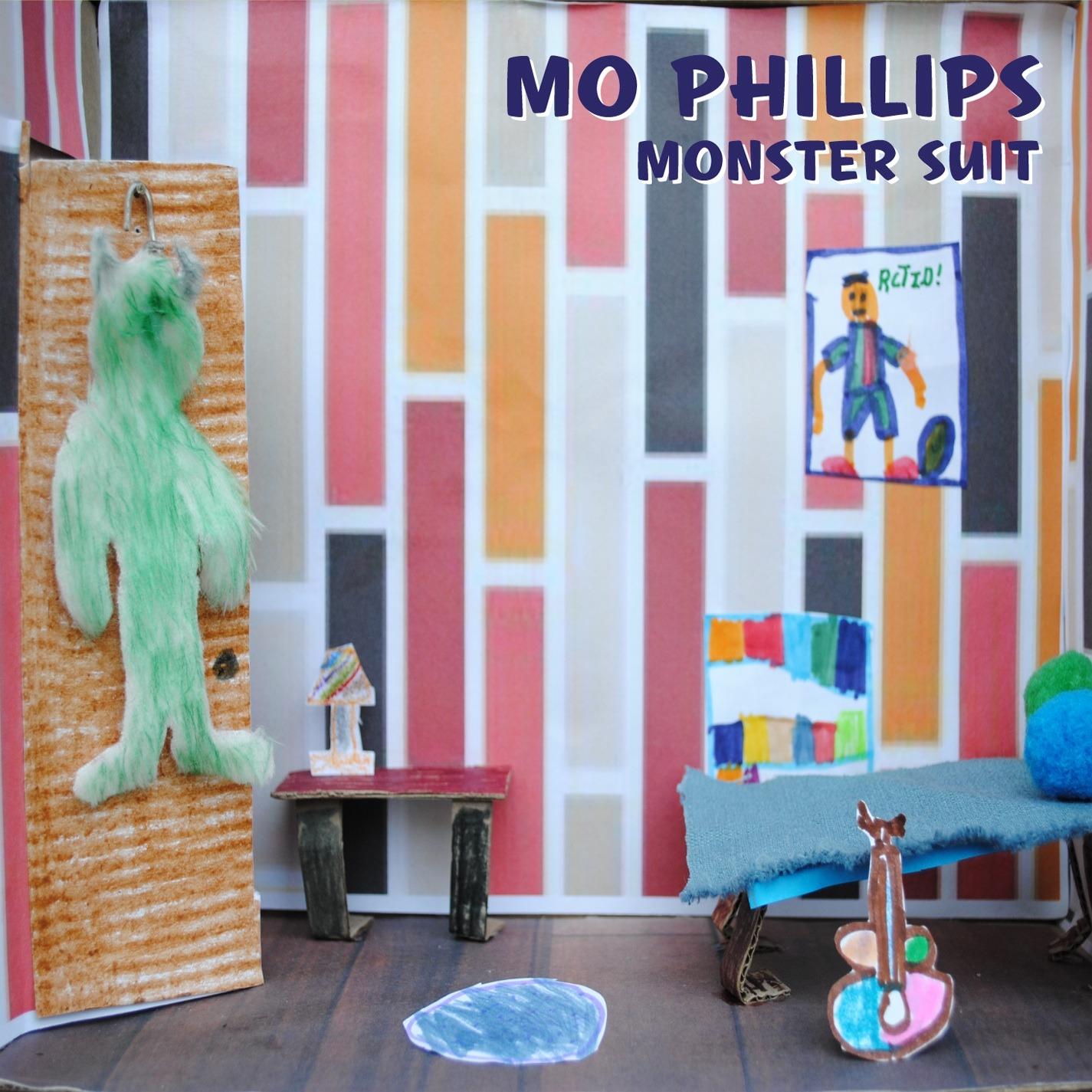 423323a419fc278b25fa_mo_phillips_monster_suit_cover_art_300_dpi.jpg