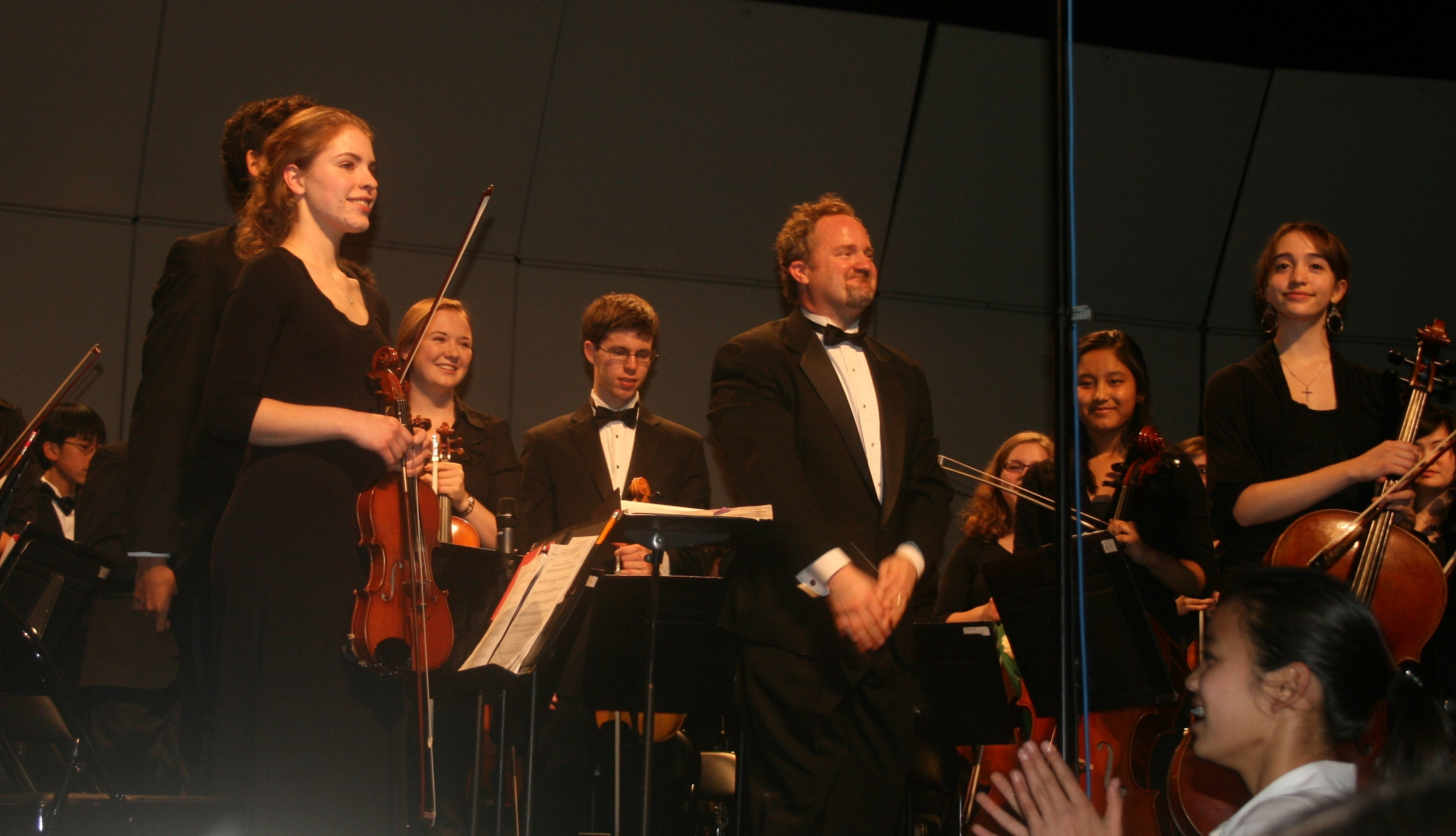 66a6e6be54ed1ce81d5d_concertmaster_and_conductor_grogan.jpg