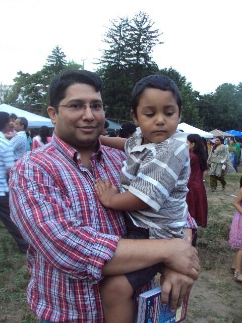 68387a509a8cd61fa558_rohel_ahmed_holding_his_son.jpg