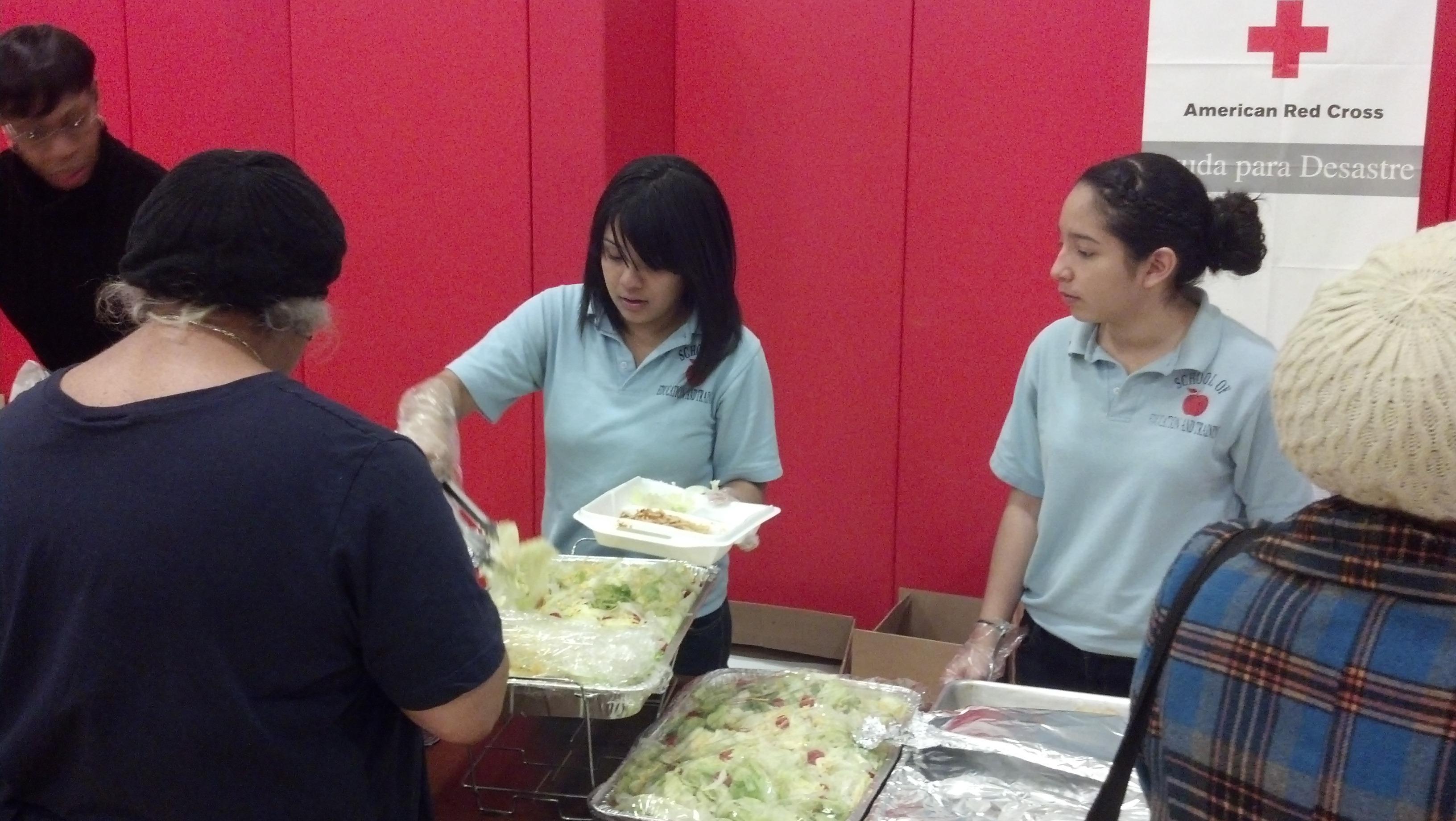 c5b97955b29f1029e4e9_jfk_robotics_members_serving_food.jpg