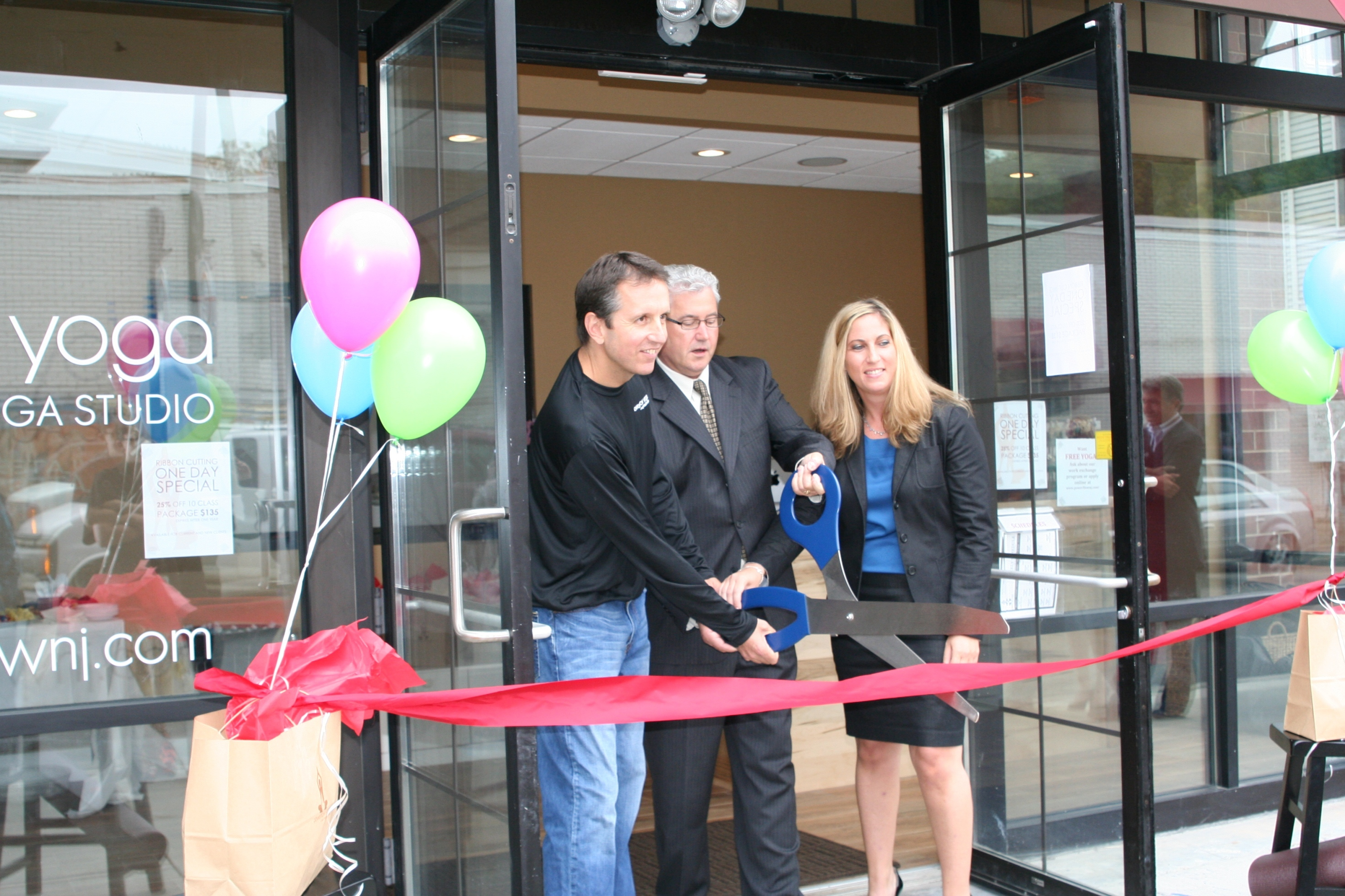fa79b14f9632c0d76630_powerflow_yoga_ribbon_cutting-a.jpg
