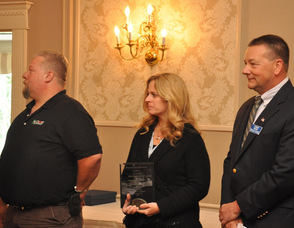 Jay and Jill Fischer of Ag Choice, with John Drake.