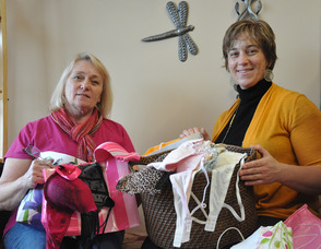 Dawn Gomez (right), with her mother Laura Gomez (left), and some of the brassieres collected for Be a Dear and Donate a Brassiere.