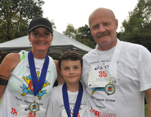 Renae, Dane (age 10), and Keith Armstrong, in their third 5K as a family.