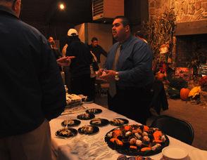 Carlos Luaces serving dessert.