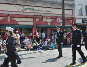 Andover Borough Fire Department marches in front of the Spring Board Shoppes.