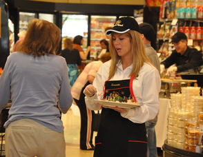 Customers at Kings Food Markets sample various gourmet offerings.