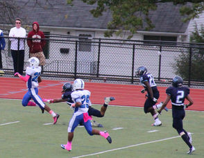 #1 Irvin Paye running hard late in the fourth quarter and would eventually score.