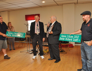 Dr. Richard Scott with Mayor Paul Crowley, flanked by Joe Limon, and, Fred Babcock, who hold the street signs.