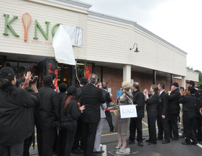 Kings Food Markets Judy Spires unveils the store's new sign.