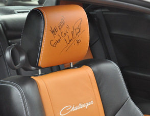 John Schneider's autograph on a General Lee's seat.