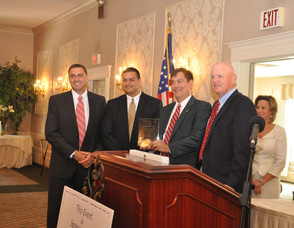 CP Engineers Ray Roggero, Joe Toscano, and Stan Puszcz, receive the Business Investment Award.