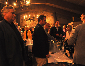 George Graham, Bob O'Gureck of R&R Marketing, and James Oscovitch, pour wine for the guests.