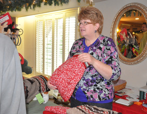 Bonnie Bitondo of Maxwell & Molly's Closet Pet Boutique holds up a sweater, ready to give to a four-legged friend.