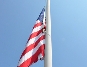 The flag flies at half-mast.