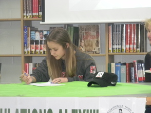 Alex Schlobohm signing her letter of intent to play soccer at Boston University