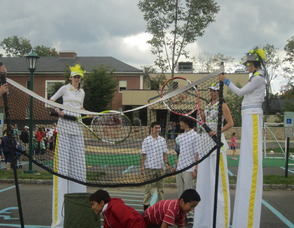People on stilts playing tennis
