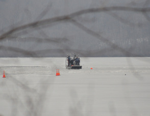 The New Jersey State Police Vessel combs the lake, and makes its way through the ice.