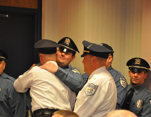 Andover Township Police Officers congratulate their colleague, Eric Danielson, after he has taken his oath as lieutenant.