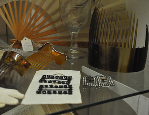 Elegant hair combs and shoe buckles are on display alongside of the Cooper Family Bible at the museum.