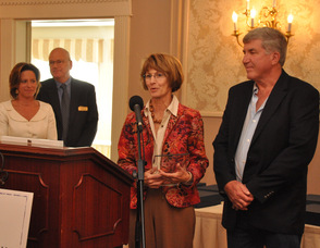 Cate and Tom Roberts of Tamarack's Country Villa accept the New Business Award.