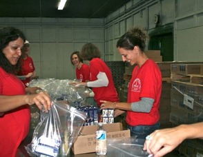 JLOSH Volunteers Packing Bags
