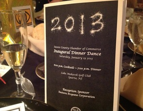 The evening's program sitting on one of the tables at the night's event.